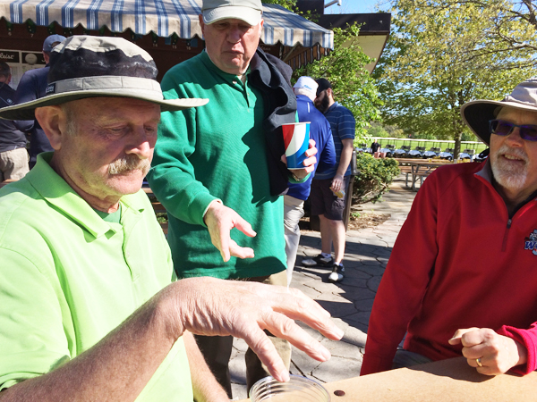 Eroll Patenaude explains the finer points of Rock, Paper, Scissors to Gordon Dalby and Jim Fourness at the International.